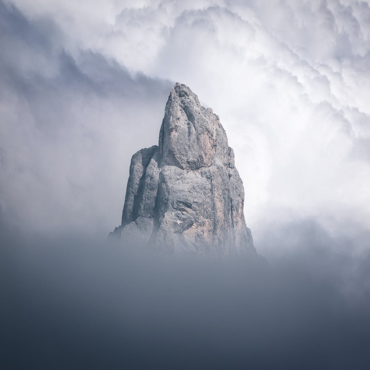brown rocky mountain under white clouds